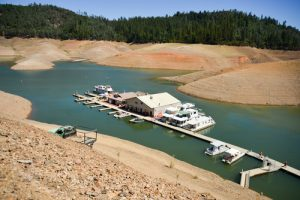 California's drought exposes the 180-200-foot drop in water levels at the Silverthorn Resort. The reservoir is receding at an average of 4.9 inches per day.