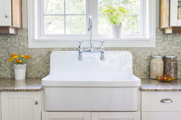 clean-looking kitchen sink in bright room