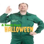 """plumber in green uniform with """"George Brazil"""" logo on right pocket making """"three-oh"""" sign"""