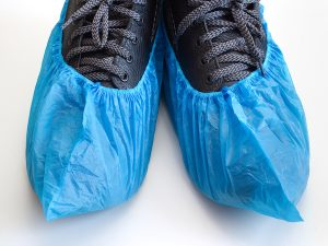 blue shoe covers over shoes
